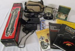 Various camera equipment and books inc Stitz tripod, Canon auto focus, Ricoh and Kodak Brownie 127