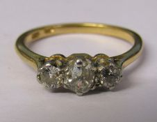18ct gold diamond trilogy ring, central stone 0.30 ct outer stones 0.10 ct each size N total