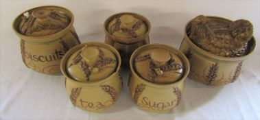 Selection of Alvingham pottery wheat and mice design lidded jars