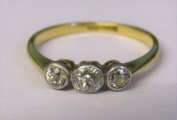 18ct gold diamond trilogy ring, central stone 0.12 ct outer stones 0.08 ct total weight 1.8 g size