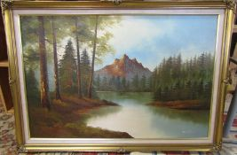 Framed oil of canvas of a mountainous scene signed Williams 102 cm x 72 cm (size including frame)