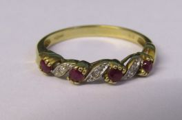 9ct gold ruby and diamond accent ring size N weight 2.1 g