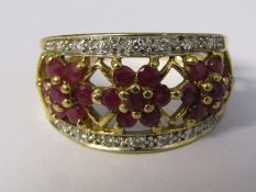 9ct gold ruby and diamond accent 3 flower ring size L weight 3 g
