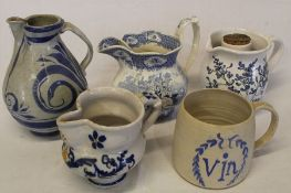 Large tin glazed earthenware jug, 3 other jugs and hand-made ale / vin mug