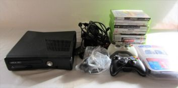 Microsoft Xbox 360S gaming console model 1439 with assorted games, headset, scart cable, power