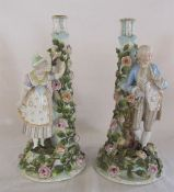 Pair of continental figural candlesticks (one repaired) H 37 cm