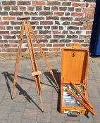 Two artists easels and paints.