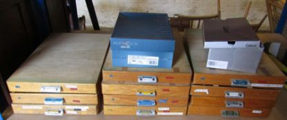 11 large drawers of watch parts & 2 boxes of parts and clamps