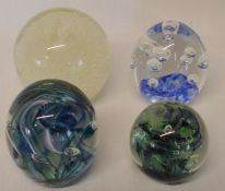 4 glass paperweights including 2 Isle of Wight