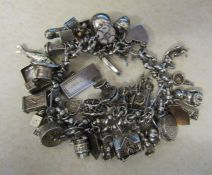 Sterling silver charm bracelet with large quantity of charms total weight 142.20 g / 4.58 ozt