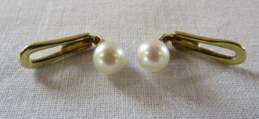 Pair of 14ct gold pearl cuff links (marked 585) total weight 2.8 g