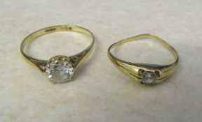 2 9ct gold solitaire dress rings total weight 2.4 g size L & O (one mis-shapen)