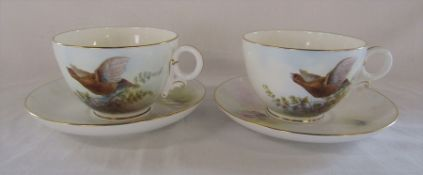 Pair of Royal Worcester 'Grouse' oversized / jumbo cup and saucers with signature from artist Arthur