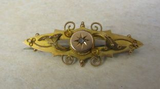 9ct gold etruscan style brooch with diamond accent, Chester 1912 L 4.5 cm weight 3.1 g