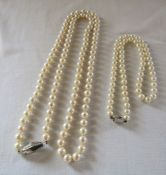 89 cm string of pearls with 14ct gold and diamond clasp & 46 cm string of pearls