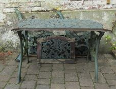 Cast iron table with matching bench and chair back panels, bench ends and chair ends