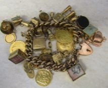 9ct gold charm bracelet with 26 9ct gold charms inc TV set, stork, bible, fob 1919, cufflinks,