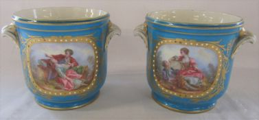 Pair of cache pots hand painted with figural and floral scenes with Sevres marks to underside H 12