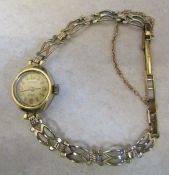 9ct gold ladies Rotary 17 jewels wrist watch with 9ct gold strap (fastening clasp in rolled gold)
