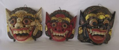 3 wooden painted tribal style masks H 27 cm and 26 cm