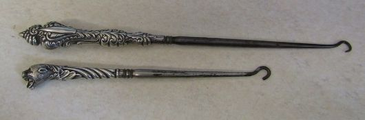 2 silver handled boot hooks inc one in the shape of a panther (hallmarks indistiguishable)