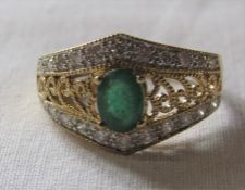 18ct gold diamond and emerald ring size R/S weight 6.9 g (emerald 7 mm x 5 mm)