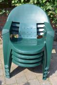 4 green plastic stacking garden chairs