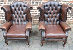 Pair of brown leather button back armchairs (tear to arm)