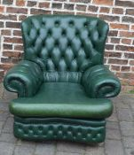Green leather Chesterfield style button back armchair