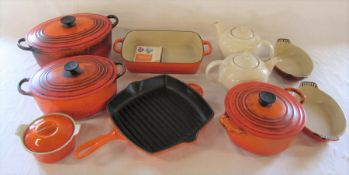 Various Le Creuset table ware inc 2 1.3L teapots, lidded casserole dishes C and F, over dish 29 2.