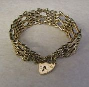 9ct gold gate bracelet and locket weight 24.3 g