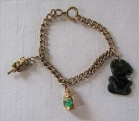 9ct gold bracelet with 2 9ct gold charms and a New Zealand nephrite Hei-tiki total weight 15.3 g (