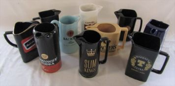 Selection of ceramic advertising jugs inc Black Label, Bacardi rum and Tennent's Extra