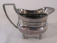 Edward VII silver cream jug with 3 banded waist on 4 ball feet London 1902 H 9 cm weight 4.33 cm