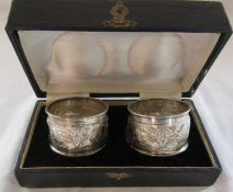 Boxed pair of napkins rings decorated with palm trees etc marked sterling silver weight 1.01 ozt