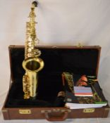 Trevor J James & Co. The Horn saxophone in a case with tutor books