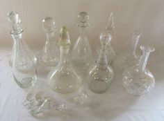 Various glass decanters and stoppers