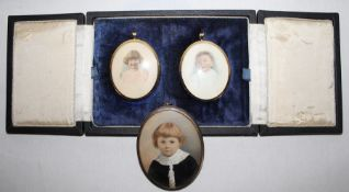 Pair of oval portrait miniatures in brass frames depicting young children, in fitted case & 1