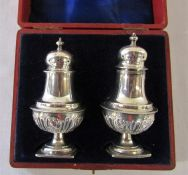 Boxed pair of Victorian silver pepper pots Birmingham 1897 (both slightly mis-shapen) weight 2.11