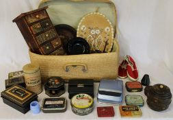 Selection of vintage tins, miniature chest of drawers, Poloroid camera, straw suitcase etc.
