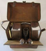 Leather cased picnic hamper consisting of leather bag (strap af) with glass decanter (chipped),