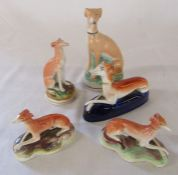 5 Staffordshire dogs / whippets including a small pair with hollow bases