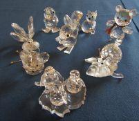 Selection of boxed Swarovski crystal figures inc ice skating bear, squirrel, penguins, cat,
