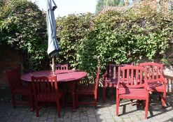 Cannock Gates hardwood stained patio table, 4 chairs, 3 bench chairs & an umbrella