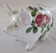 Wemyss ware seated pig glazed in white with clover pattern L 16 cm H 10.5 cm