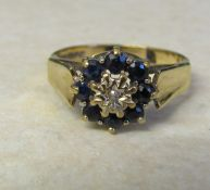 9ct gold sapphire and diamond daisy ring size S weight 4.4 g