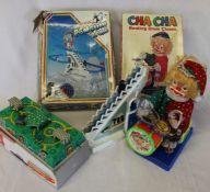 Russian tinplate clockwork moving vehicles scene, Cha Cha drumming clown & Playful Penguin Vale (all