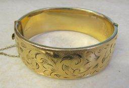 9ct gold bangle with metal core (1/5 9ct gold) total weight 52.8 g