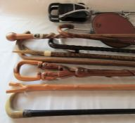 Assorted walking and shooting sticks inc one with silver cuff