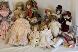 Quantity of modern bisque head dolls including Ashton Drake & some doll stands